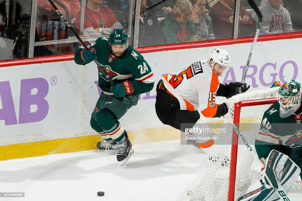 Matt Dumba #24 of the Minnesota Wild and Jori Lehtera #15 of the Philadelphia Flyers battle for the puck during the game at the Xcel Energy Center on November 14, 2017 in St. Paul, Minnesota.