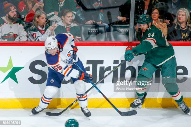 Matt Dumba of the Minnesota Wild and Mark Letestu of the Edmonton Oilers battle for the puck during the game at the Xcel Energy Center on December 16...