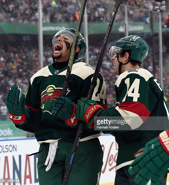 Matt Dumba of the Minnesota Wild celebrates his goal along with Justin Fontaine at 3:25 of the first period against the Chicago at the TCF Bank...