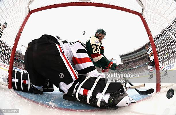 Matt Dumba of the Minnesota Wild scores against goaltender Corey Crawford of the Chicago Blackhawks in the first period of the 2016 Coors Light...