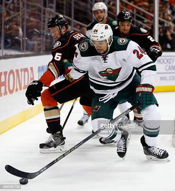Matt Dumba of the Minnesota Wild skates to the puck past Jiri Sekac of the Anaheim Ducks and Kevin Bieksa of the Anaheim Ducks during the second...