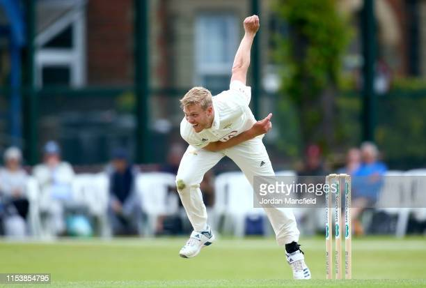 Matt Dunn of Surrey bowls during day three of the Specsavers County Championship Division One match between Surrey and Somerset at Woodbridge Road on...