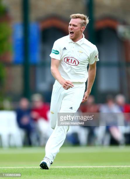 Matt Dunn of Surrey celebrates dismissing Tom Banton of Somerset during day three of the Specsavers County Championship Division One match between...