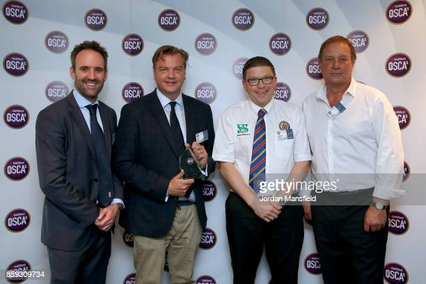 Matt Dwyer Director of Participation Growth for the ECB presents the Leagues and Boards Awards to Andy Hunt of Nottinghamshire Anthony Briggs of...