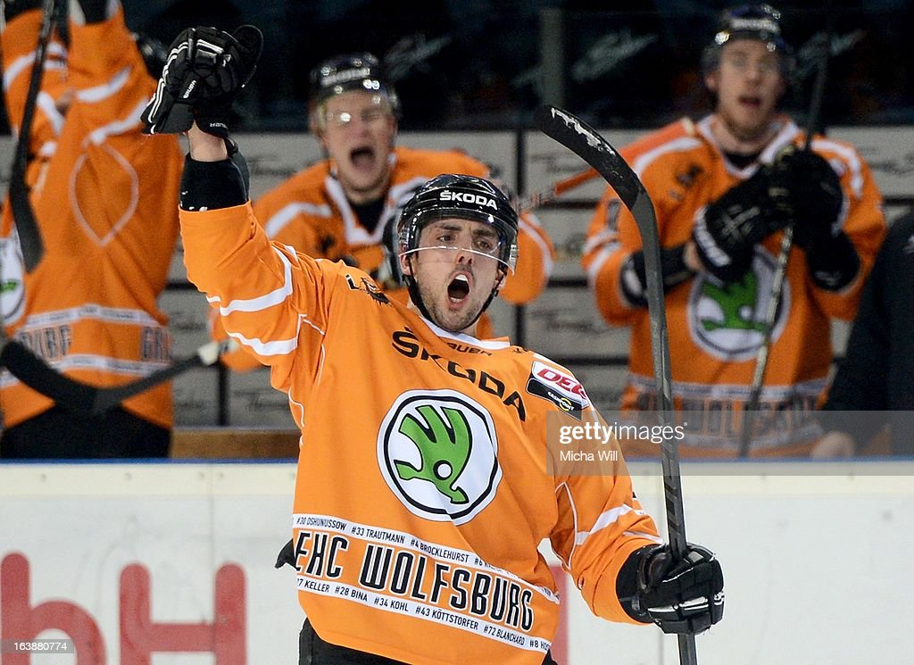 Matt Dzieduszycki of Wolfsburg celebrates after scoring his team's third goal during game three of the DEL pre-play-offs between Thomas Sabo Ice Tigers and Grizzly Adams Wolfsburg on March 17, 2013 in Nuremberg, Germany.
