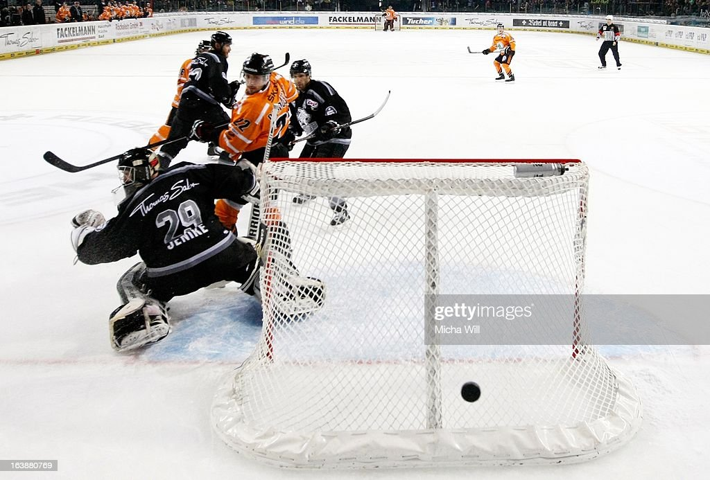 Matt Dzieduszycki (3rd L) of Wolfsburg misses to score during game three of the DEL pre-play-offs between Thomas Sabo Ice Tigers and Grizzly Adams Wolfsburg on March 17, 2013 in Nuremberg, Germany.