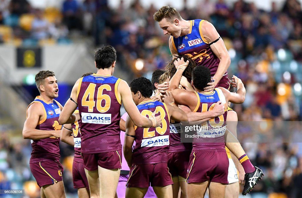 Matt Eagles of the Lions is congratulated by team mates after kicking a goal during the round nine AFL match between the Brisbane Lions and the Hawthorn Hawks at The Gabba on May 20, 2018 in Brisbane, Australia.