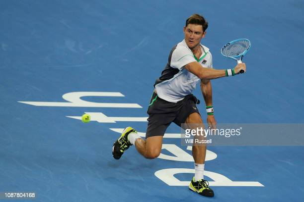 Matt Ebden of Australia plays a backhand to Lucas Pouille of France in the mens singles match during day one of the 2019 Hopman Cup at RAC Arena on...
