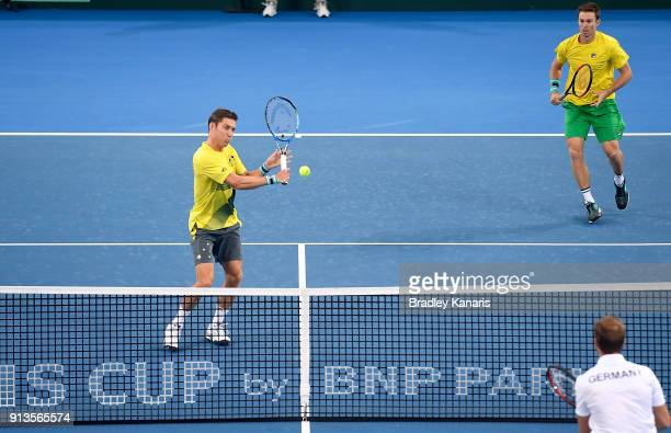 Matt Ebden of Australia plays a backhand volley in the doubles match with John Peers against Jan-Lennard Struff and Tim Putz of Germany during the...