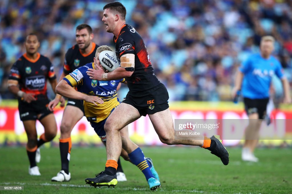 Matt Eisenhuth of the Tigers breaks away to score a try during the round Eight NRL match between the Parramatta Eels and the Wests Tigers at ANZ Stadium on April 29, 2018 in Sydney, Australia.