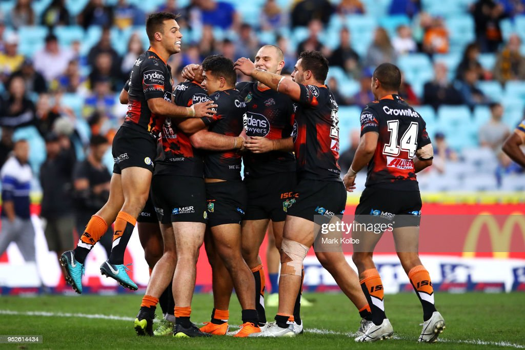 Matt Eisenhuth of the Tigers celebrates with his team mates after scoring a try during the round Eight NRL match between the Parramatta Eels and the Wests Tigers at ANZ Stadium on April 29, 2018 in Sydney, Australia.