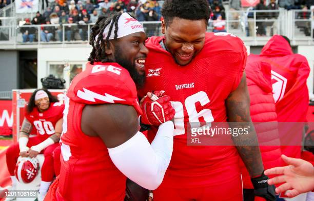 Matt Elam and Jay Bromley of the DC Defenders celebrate against the New York Guardians at Audi Field on February 15 2020 in Washington DC
