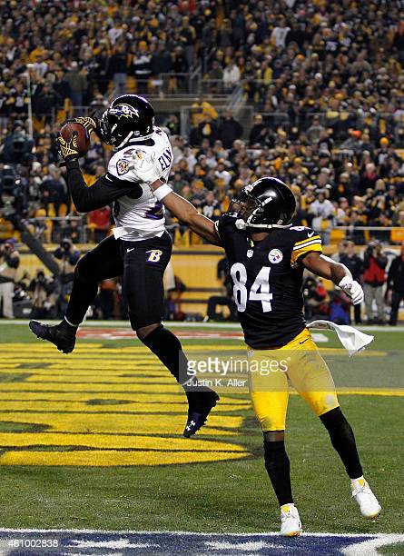 Matt Elam of the Baltimore Ravens intercepts an attempted twopoint conversion intended for Antonio Brown of the Pittsburgh Steelers during their AFC...
