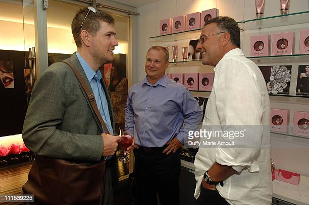Matt Evans of WWD Andy Clark and Inter Parfums CEO Jean Mader attend the fragrance launch at Inter Parfums on August 6 2009 in New York City