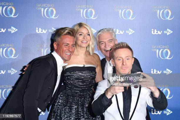 Matt Evers Ian H Watkins Holly Willoughby and Phillip Schofield take a selfie together during the Dancing On Ice 2019 photocall at ITV Studios on...