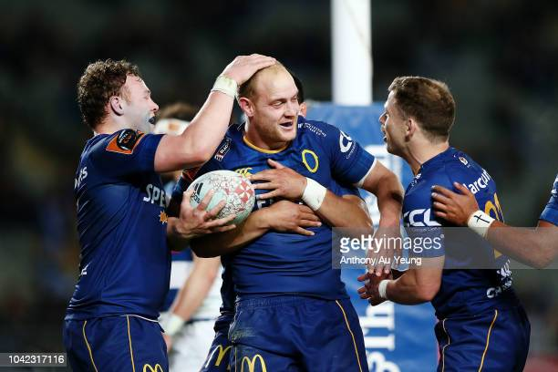 Matt Faddes of Otago celebrates with teammates after scoring a try during the round seven Mitre 10 Cup match between Auckland and Otago at Eden Park...