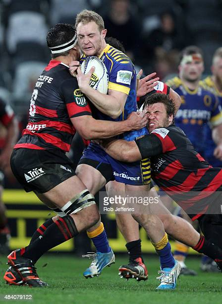 Matt Faddes of Otago is wrapped up by the Canterbury defence during the round one ITM Cup match between Otago and Canterbury at Forsyth Barr Stadium...