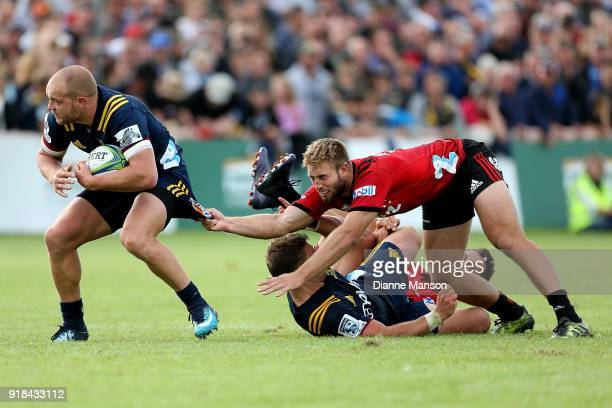 Matt Faddes of the Highlanders breaks the tackle of Braydon Ennor of the Crusaders during the Super Rugby trial match between the Highlanders and the...
