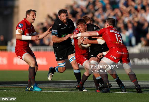 Matt Fagerson of Glasgow Warriors is tackled by Rhys Patchell of Scarlets during the Guinness Pro14 Semi Final match between Glasgow Warriors and...