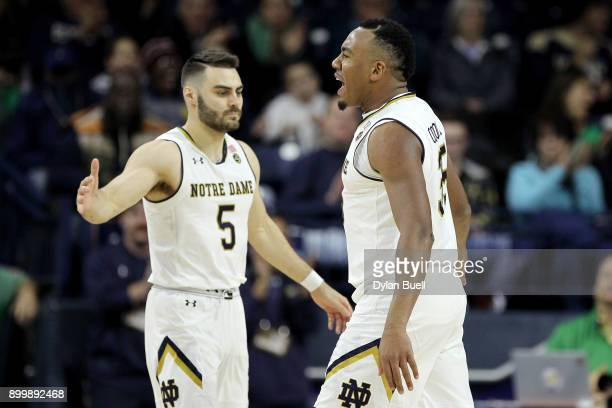 Matt Farrell and Bonzie Colson of the Notre Dame Fighting Irish react in the second half against the Georgia Tech Yellow Jackets at Purcell Pavilion...