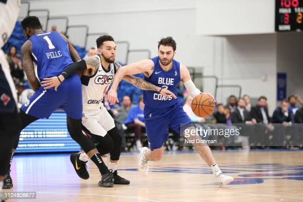 Matt Farrell of the Delaware Blue Coats drives against Chris Chiozza of the Capital City GoGo during an NBA GLeague game at the 76ers Fieldhouse on...