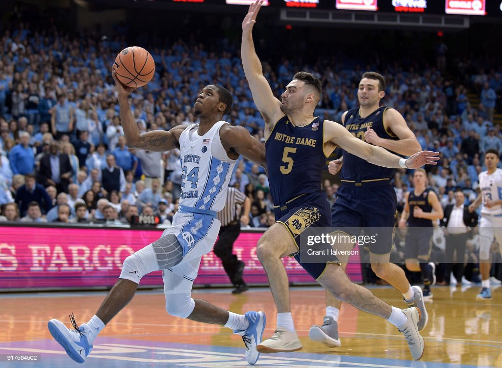 Matt Farrell #5 of the Notre Dame Fighting Irish defends a fast break by Kenny Williams #24 of the North Carolina Tar Heels during their game at the Dean Smith Center on February 12, 2018 in Chapel Hill, North Carolina. North Carolina won 83-66.