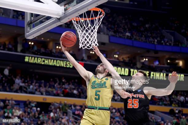 Matt Farrell of the Notre Dame Fighting Irish shoots the ball against Steven Cook of the Princeton Tigers during the first round of the 2017 NCAA...