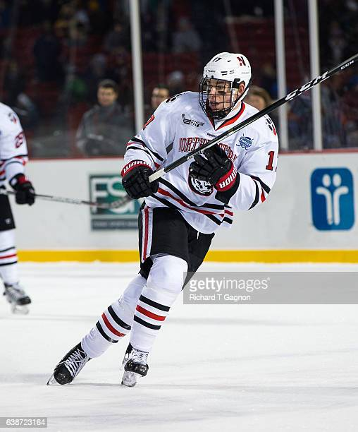 """Matt Filipe of the Northeastern Huskies skates against the New Hampshire Wildcats during NCAA hockey at Fenway Park during """"Frozen Fenway"""" on January..."""
