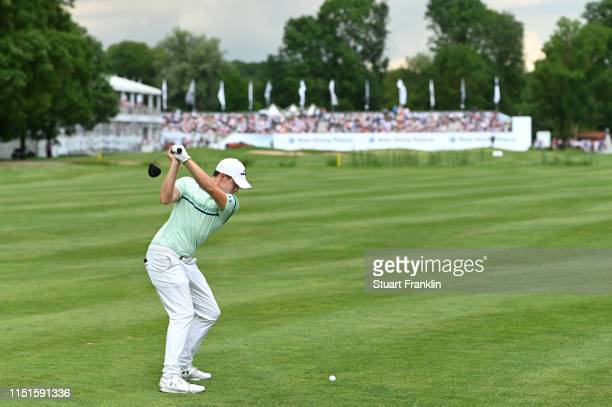 Matt Fitzpatrick of England hits an approach shot on the 18th hole during day four of the BMW International Open at Golfclub Munchen Eichenried on...