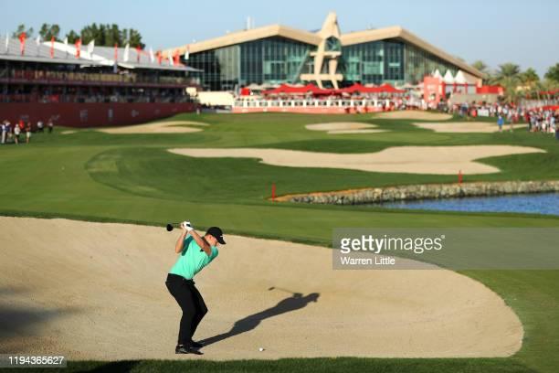 Matt Fitzpatrick of England hits his second shot on the 18th hole during Day Three of the Abu Dhabi HSBC Championship at Abu Dhabi Golf Club on...