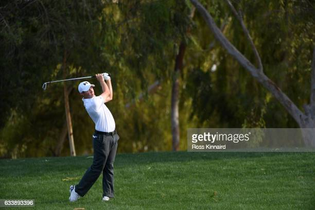 Matt Fitzpatrick of England hits his second shot on the 18th hole during the final round of the Omega Dubai Desert Classic at Emirates Golf Club on...
