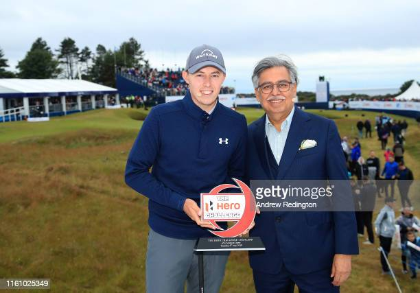 Matt Fitzpatrick of England poses with the trophy alongside Pawan Munjal Chairman of Hero MotoCorp after winning the Hero Challenge for the Aberdeen...
