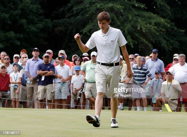 Matt Fitzpatrick of England reacts on the 12th green in the first round of the 2013 U.S. Amateur Championship at The Country Club on August 18, 2013...