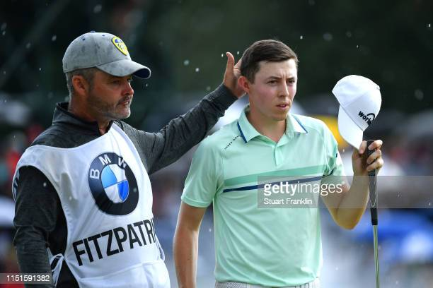 Matt Fitzpatrick of England reacts with caddie Billy Foster on the 18th green during day four of the BMW International Open at Golfclub Munchen...