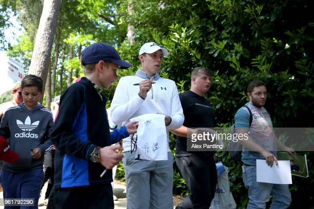 Matt Fitzpatrick of England signs autographs during the Pro Am for the BMW PGA Championship at Wentworth on May 23 2018 in Virginia Water England