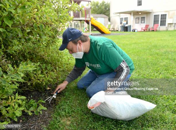 Matt Flamisch, a supervisor in the Small Business Department at Herbein , works on weeding. At Hannah's Hope Ministries in Reading Thursday morning...