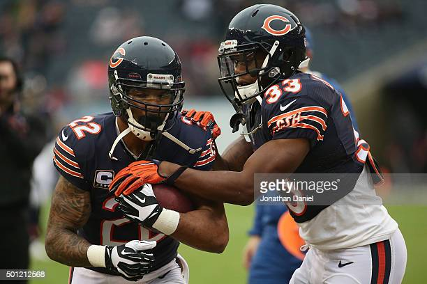 Matt Forte and Jeremy Langford of the Chicago Bears warm up against the Washington Redskins at Soldier Field on December 13, 2015 in Chicago,...