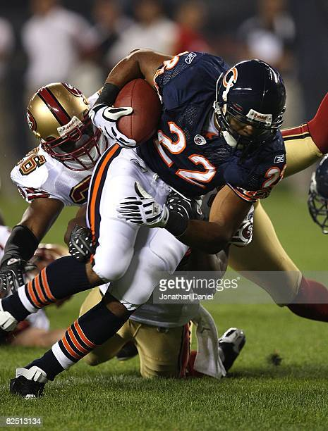 Matt Forte of the Chicago Bears breaks away from Mark Roman of the San Francisco 49ers on August 21 2008 at Soldier Field in Chicago Illinois The...
