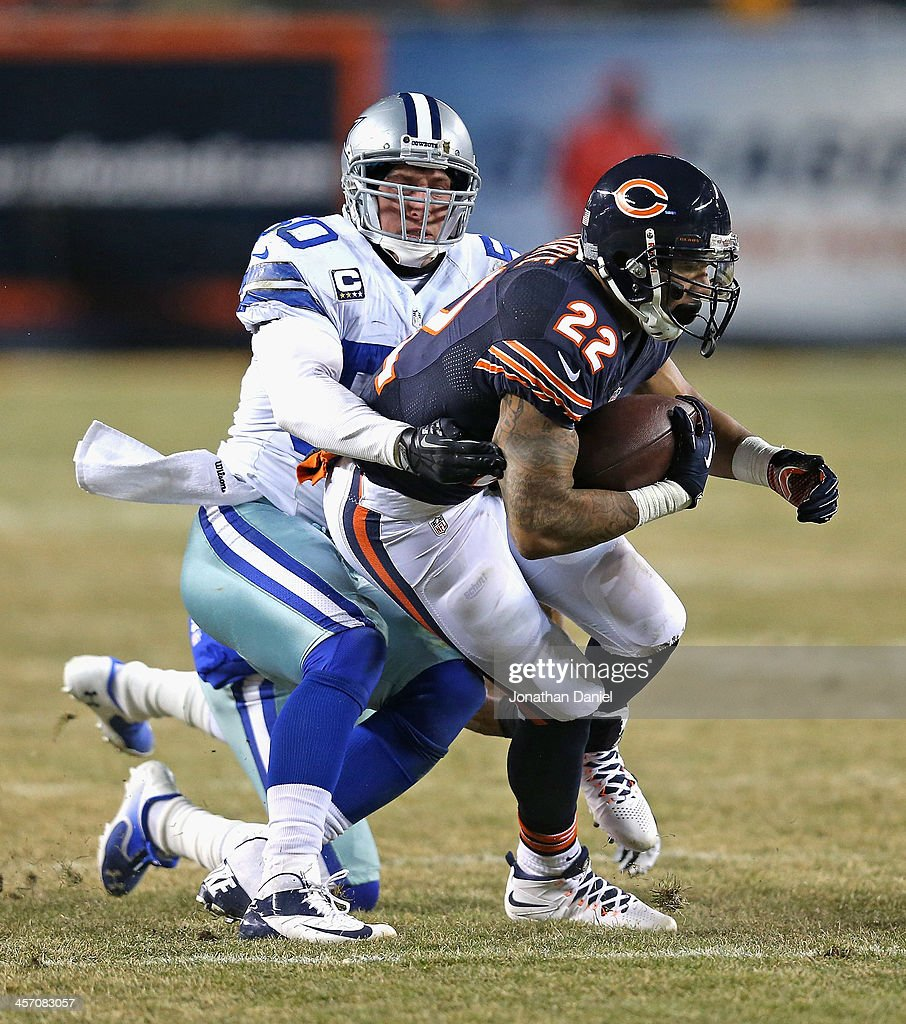 Matt Forte #22 of the Chicago Bears breaks away from Sean Lee #50 of the Dallas Cowboys at Soldier Field on December 9, 2013 in Chicago, Illinois. The Bears defeated the Cowboys 45-28.