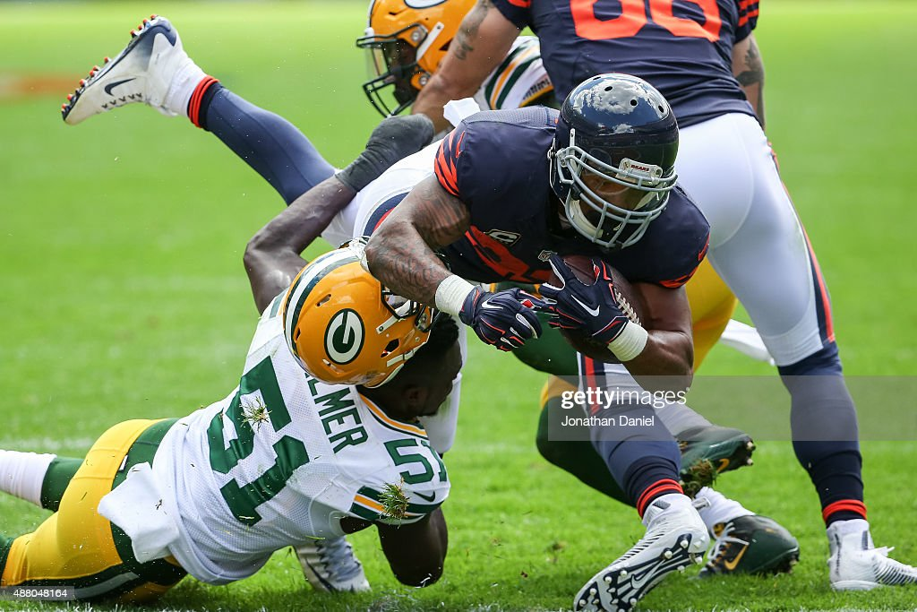 Matt Forte #22 of the Chicago Bears carries the football for a touchdown against Nate Palmer #51 of the Green Bay Packers in the second quarter at Soldier Field on September 13, 2015 in Chicago, Illinois.