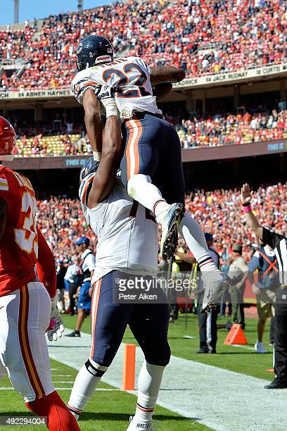 Matt Forte of the Chicago Bears celebrates a go ahead touchdown with Charles Leno of the Chicago Bears at Arrowhead Stadium during the game on...
