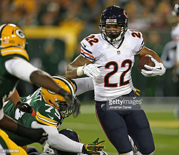 Matt Forte of the Chicago Bears escapes Ryan Pickett of the Green Bay Packers at Lambeau Field on November 4, 2013 in Green Bay, Wisconsin. The Bears...