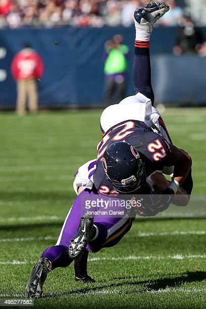 Matt Forte of the Chicago Bears is hit by Harrison Smith of the Minnesota Vikings resulting in Forte having a leg injury and leaving the game in the...