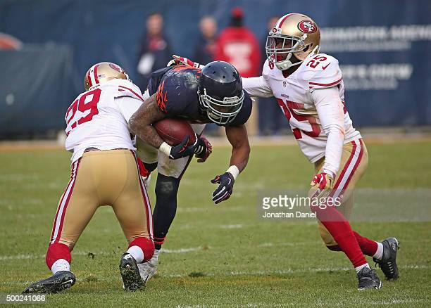 Matt Forte of the Chicago Bears is hit by Jaquiski Tartt and Jimmie Ward of the San Francisco 49ers at Soldier Field on December 6, 2015 in Chicago,...