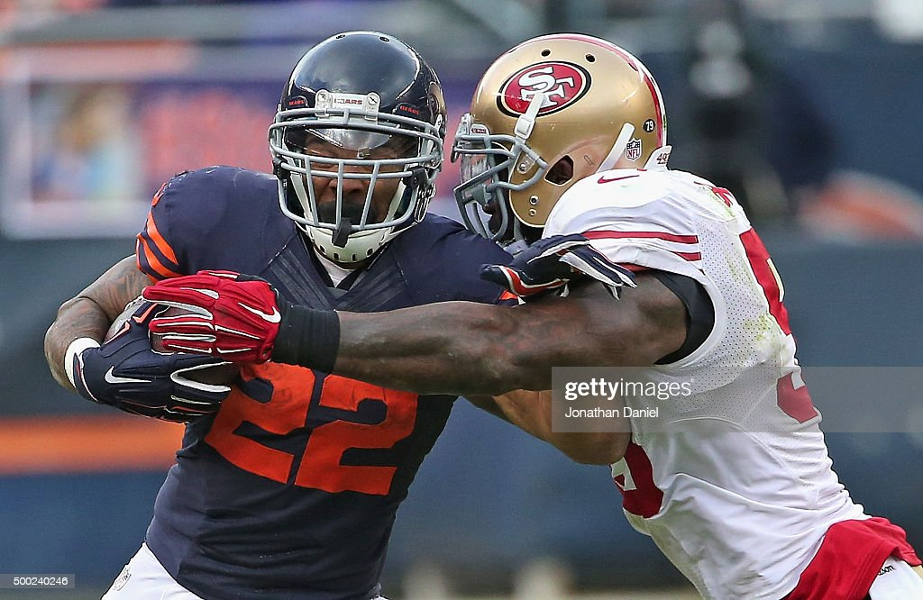 Matt Forte #22 of the Chicago Bears is hit by NaVorro Bowman #53 of the San Francisco 49ers at Soldier Field on December 6, 2015 in Chicago, Illinois. The 49ers defeated the Bears 26-20 in overtime.