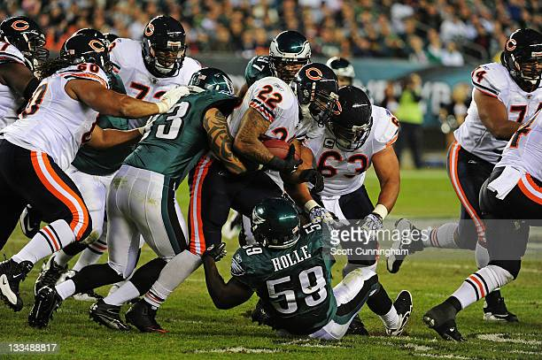 Matt Forte of the Chicago Bears is tackled by Brian Rolle and Jason Babin of the Philadelphia Eagles at Lincoln Financial Field on November 7 2011 in...