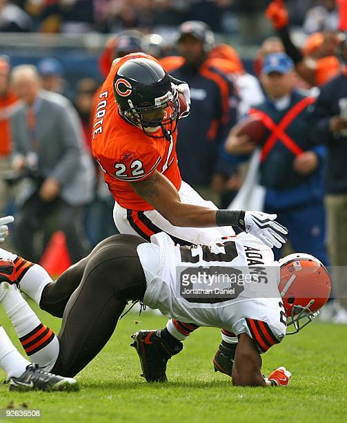Matt Forte of the Chicago Bears is tackled by Mike Adams of the Cleveland Browns at Soldier Field on November 1 2009 in Chicago Illinois The Bears...