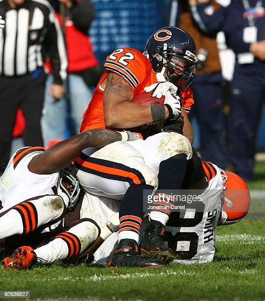 Matt Forte of the Chicago Bears is tackled by Robaire Smith of the Cleveland Browns at Soldier Field on November 1 2009 in Chicago Illinois The Bears...
