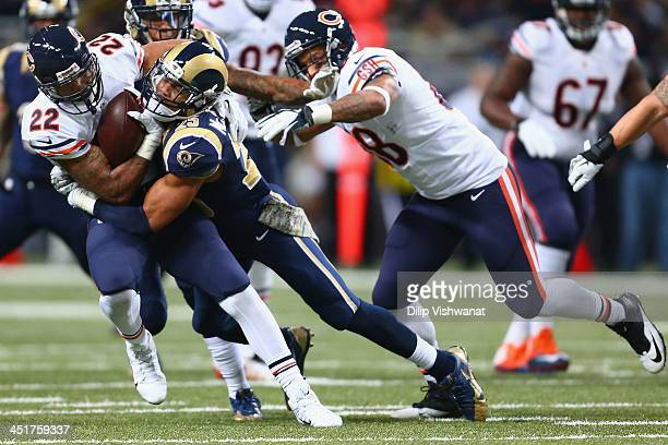 Matt Forte of the Chicago Bears is tackled by TJ McDonald of the St Louis Rams at the Edward Jones Dome on November 24 2013 in St Louis Missouri