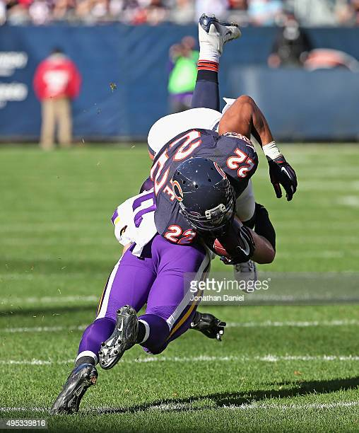 Matt Forte of the Chicago Bears is upended by Harrison Smith of the Minnesota Vikings at Soldier Field on November 1 2015 in Chicago Illinois The...